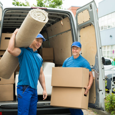 bigstock-Workers-Carrying-Carpet-And-Ca-96724205
